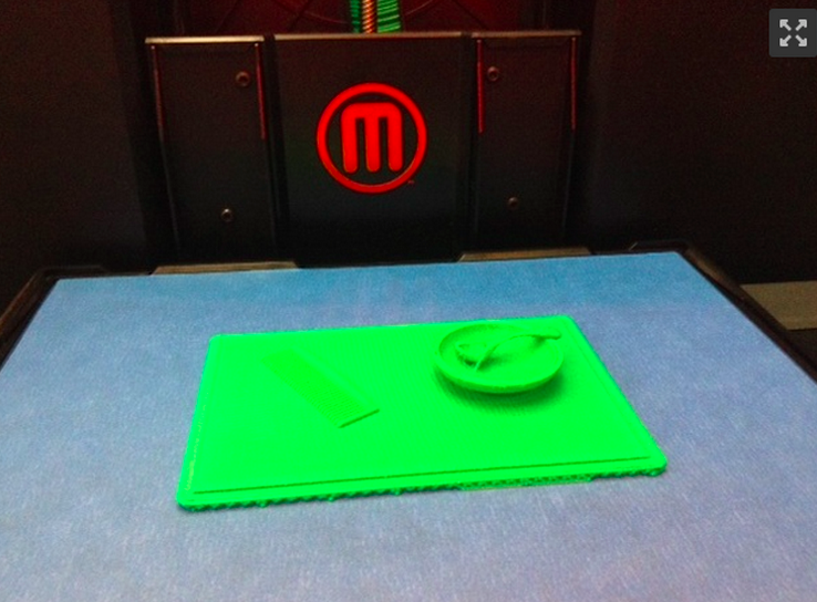 This is a picture of a 3D print, on the bed of a 3D printer.