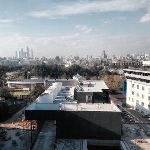 A view of the Moscow skyline. In the foreground of the image is a big building and in the horizon there are multiple buildings rising into the sky.