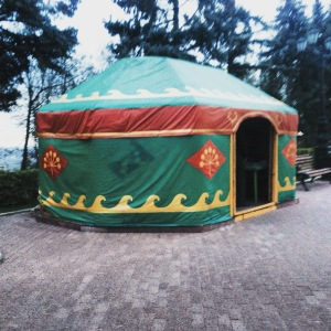 A yurt made of canvas and plastic with wave symbols and flower symbols on the surface.